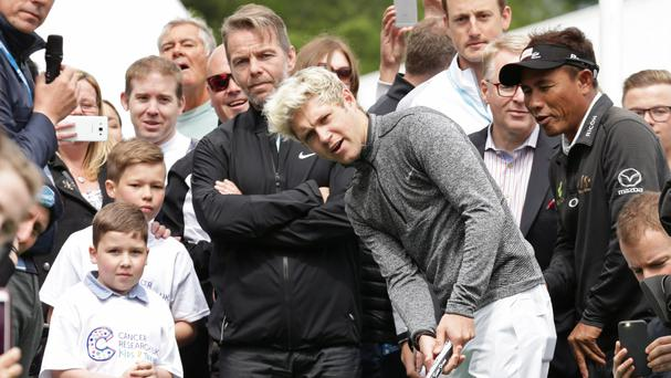 Former One Direction singer Niall Horan with eight-year-old cancer survivor, Rhys Kiernan (left) during the Mega Putt Challenge for Cancer Research UK