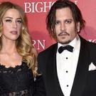 Amber Heard and Johnny Depp, pictured in January at the Palm Springs International Film Festival Awards Gala (AP)