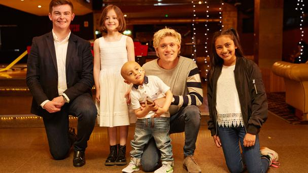 One Direction star Niall Horan surprised young cancer sufferers with a surprise visit (Cancer Research UK/PA)