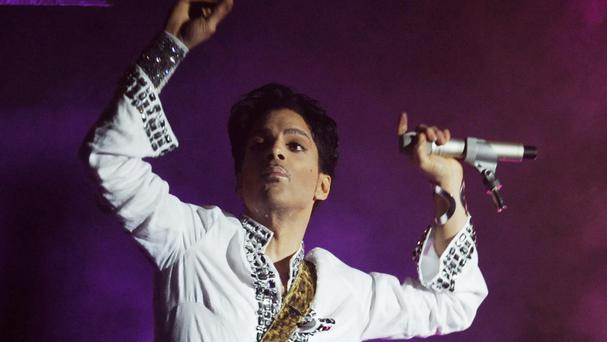 Cousin: Family held private service for Prince