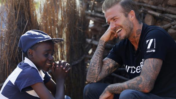 David Beckham meets 14-year-old Sebenelle in Makhewu, Swaziland (Unicef/PA)