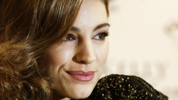 Kelly Brook says she has no problem with an image of herself being changed to improve it