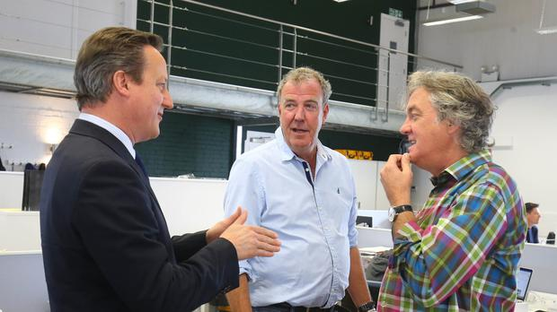 Prime Minister David Cameron meets Jeremy Clarkson and James May in west London.