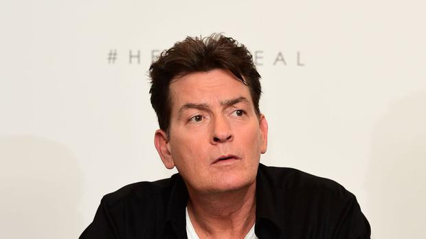 Charlie Sheen at a press conference to endorse Lelo Hex condoms at the Westbury Hotel, London.