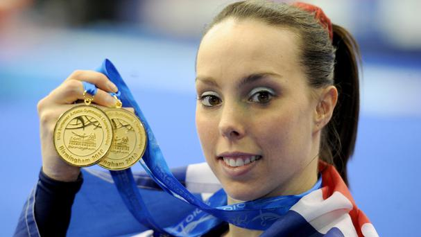 Great Britain's Beth Tweddle poses with her two gold medals during the European Artistic Championships at the NIA, Birmingham.