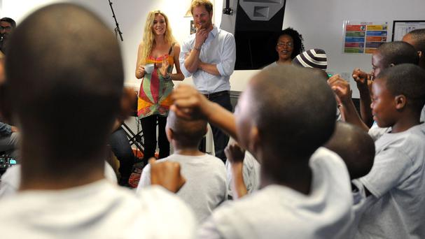 Prince Harry and Joss Stone watch members of the Basotho Youth Choir
