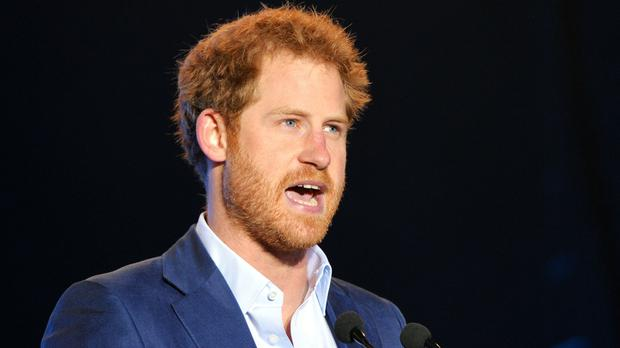 Prince Harry speaks during a concert hosted by his charity Sentebale in Kensington Palace Gardens, London, to raise awareness and funds for adolescents living with HIV in sub-Saharan Africa.