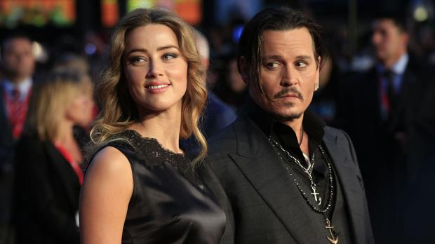 Johnny Depp had his tattoo dedicated to Amber altered to read 'Scum'