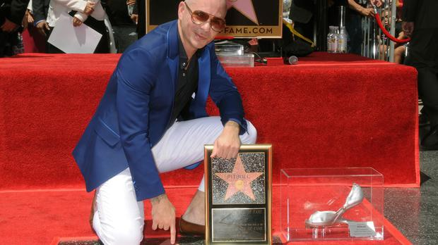 Pitbull poses with his new star on the Hollywood Walk of Fame (Hollywood Chamber of Commerce/AP)