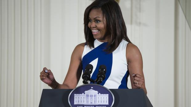 Michelle Obama will join James Corden for the popular Carpool Karaoke sketch on his US TV show (AP)