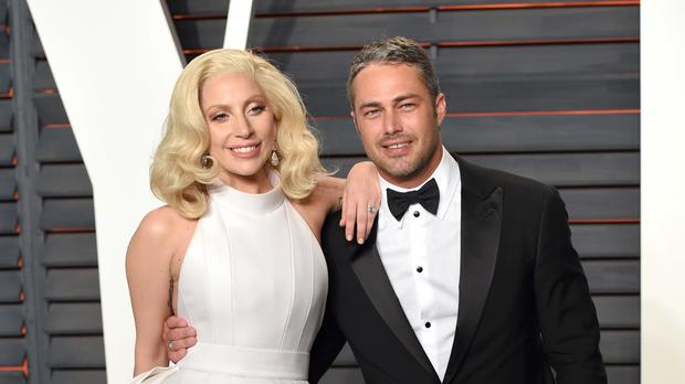 Lady Gaga and Taylor Kinney arriving at the Vanity Fair Oscar Party in February - the couple have temporarily split up, their publicist said