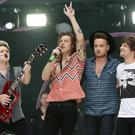 One Direction's Harry Styles and Louis Tomlinson thanked fans on Twitter as the band celebrated six years together