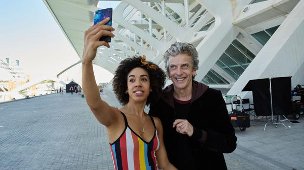 Peter Capaldi and Pearl Mackie taking a selfie in Valencia, where they are filming an episode of Doctor Who at the City of Arts and Science Museum