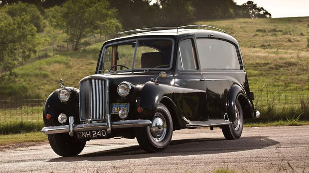 The 1956 Austin Princess that was the personal property of John Lennon and featured in the 1972 film Imagine (Stephen Kim/RM Sotheby's/PA)