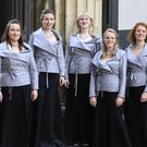 Women of the Monteverdi Choir wear new jackets designed by Dame Vivienne Westwood and Andreas Kronthaler at Henry Wood Hall in London