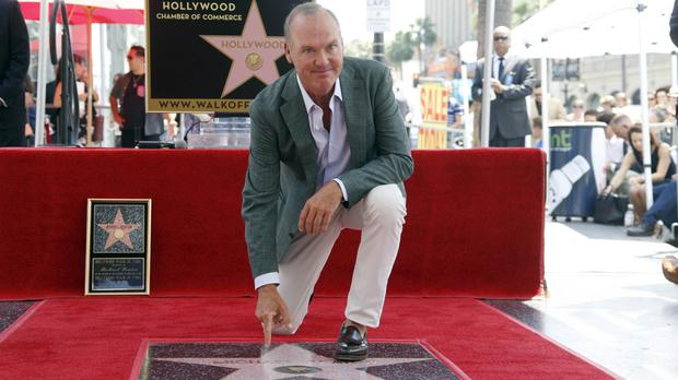 Michael Keaton with his star on the Hollywood Walk of Fame in Los Angeles (AP)