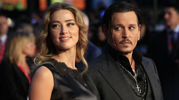 Amber Heard arrived 90 minutes late for divorce proceedings