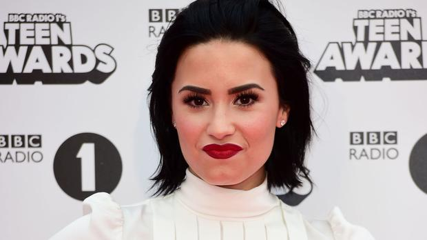 Demi Lovato has come under fire from fans for sharing a video of her mother joking about the Zika virus