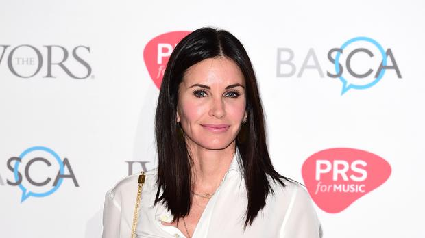 Courteney Cox has admitted that she regrets succumbing to the pressure to look young in Hollywood