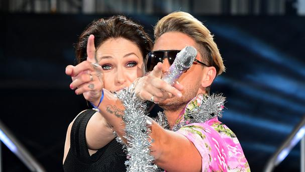 Stephen Bear hugs Emma Willis after winning the live final of Celebrity Big Brother, but was unco-operative in the interview