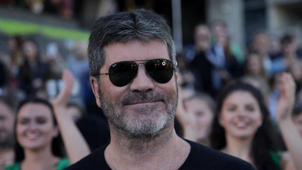 A man has been charged with burglary after a break-in at Simon Cowell's mansion