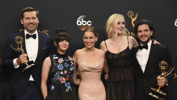 Nikolaj Coster-Waldau, Maisie Williams, Emilia Clarke, Sophie Turner and Kit Harington with the awards won by Game Of Thrones at the Emmys (AP)