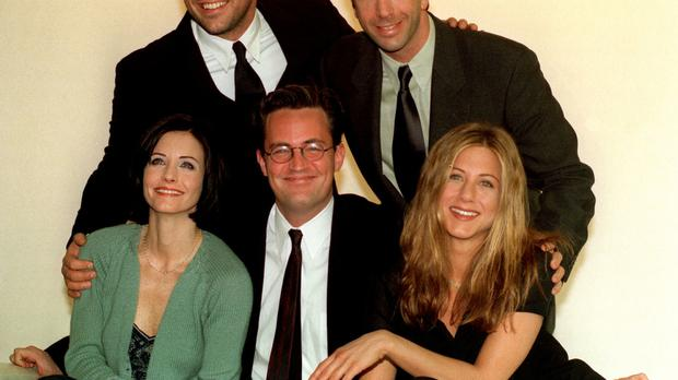 Jennifer Aniston (right) should not figure in talk about Brad Pitt's marriage break-up, according to Courteney Cox (left)