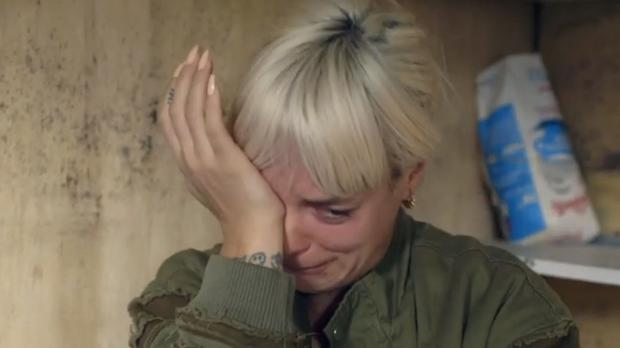 Lily Allen breaking down in tears as she meets a 13-year-old boy from Afghanistan during her visit to the Calais camp known as the Jungle (Picture: BBC)