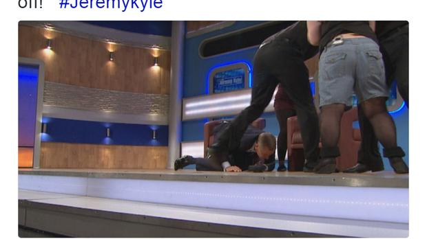 Screen grab of a tweet posted by The Jeremy Kyle Show showing the moment when chat show host Jeremy Kyle tumbled to the floor in shock as a guest stormed unannounced onto the stage to launch herself at her own sister