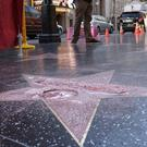 Donald Trump's vandalised star has been cordoned off (AP)