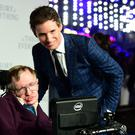 Stephen Hawking with Eddie Redmayne at the premiere of The Theory Of Everything