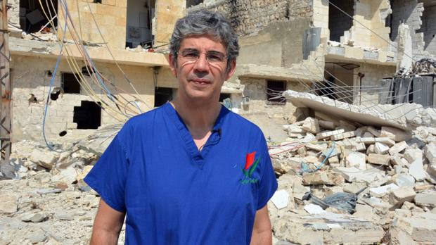 NHS surgeon David Nott won the Pride of Britain Special Recognition award for taking unpaid leave every year for 23 years to work as a volunteer for aid agencies (Channel 4/PA Wire)
