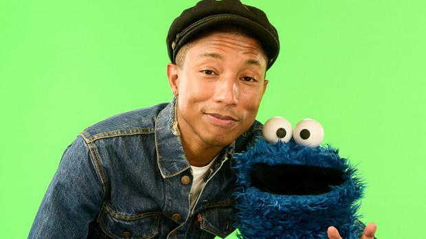 Pharrell Williams with character Cookie Monster (Sesame Street/PA)