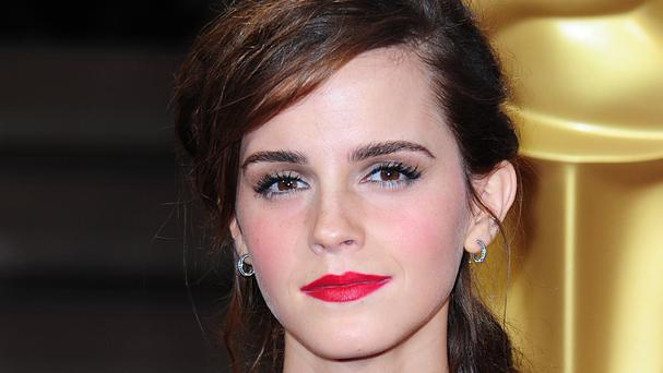 Emma Watson hides books in the London subway system