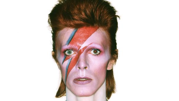 Photo of the album cover shoot for Aladdin Sane by Brian Duffy, with make-up by Pierre La Roche, part of Victoria And Albert Museum's David Bowie Is exhibition (Victoria And Albert Museum/PA)
