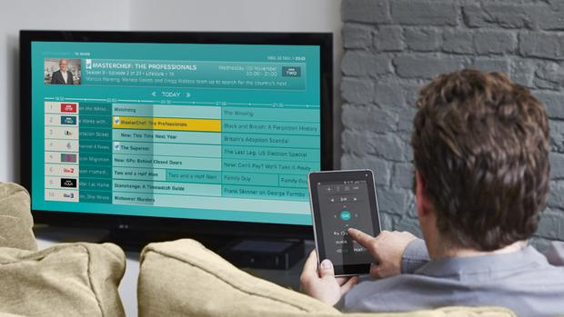A customer using EE's TV service (EE/PA)