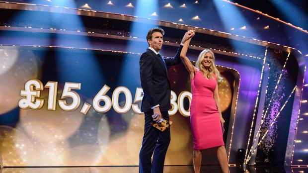 Presenters Greg James and Tess Daly with the first totaliser on BBC Children in Need