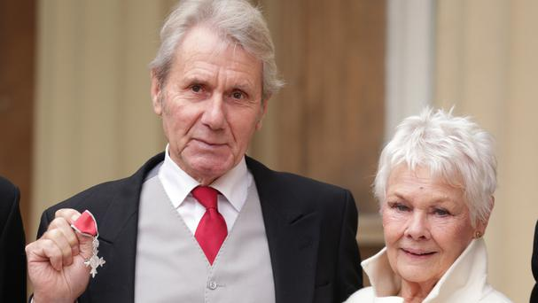 Dame Judi Dench and David Mills with his MBE, which he received by the Prince of Wales during an investiture ceremony at Buckingham Palace