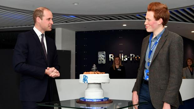 The Duke of Cambridge is presented with a cake by Aerospace engineer and Bake Off runner-up Andrew Smyth during a visit to the Rolls-Royce's aero engine factory in Derby.