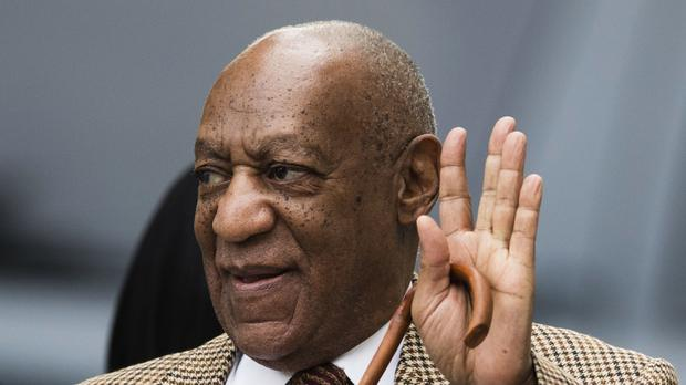 Bill Cosby waves as he arrives for a pretrial hearing in his sexual assault case at the Montgomery County Courthouse in Norristown (AP)