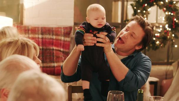 Jamie Oliver with his son four-month-old son River Rocket during his new Christmas show (Channel 4/PA)