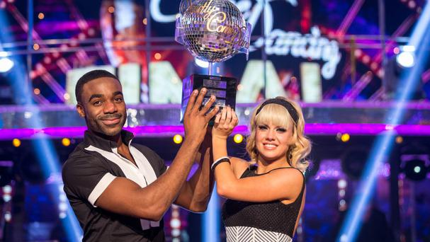 Joanne Clifton and Ore Oduba with the Glitterball trophy after they won the final of Strictly Come Dancing (BBC/PA)