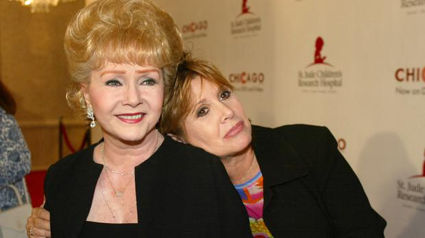 Debbie Reynolds and daughter Carrie Fisher pictured in 2003 (AP)