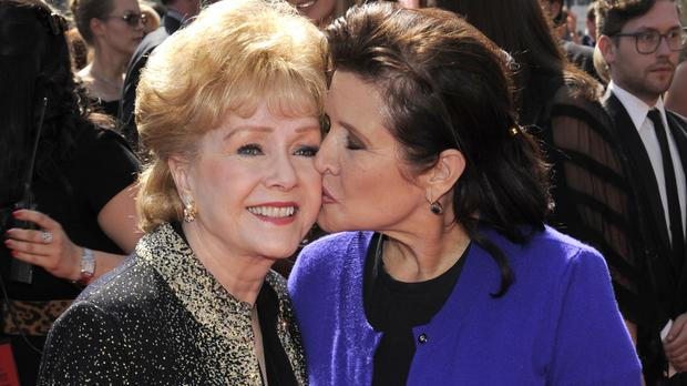 Debbie Reynolds, left, and daughter Carrie Fisher (AP)