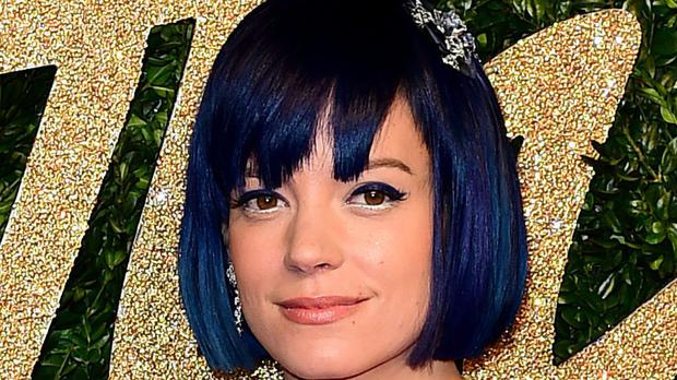 Singer Lily Allen became embroiled in a Twitter row with Tommy Robinson