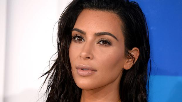 Kim Kardashian West feared she was going to be shot in the back when she was held at gunpoint by armed robbers in Paris