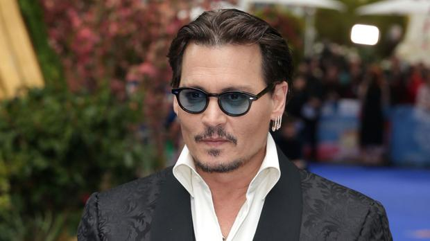 Johnny Depp claims his former business managers lost him millions of dollars