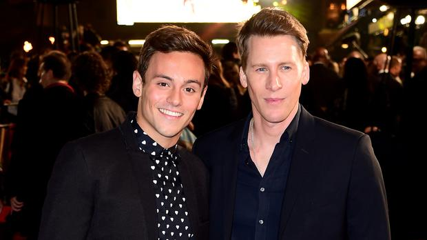 Tom Daley, left, and fiance Dustin Lance Black
