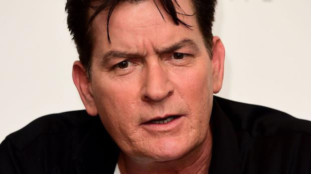 Charlie Sheen has apologised for his comments and offered to buy Rihanna a drink
