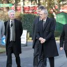 Status Quo band members, including Francis Rossi, centre, arrive at Rick Parfitt's funeral
